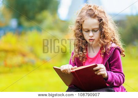 Little Girl Reading The Book. Education Concept.
