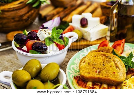 Greek cuisine dishes - Greek salad, choriatiki, halloumi, tzatziki
