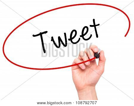 Man Hand writing Tweet with black marker on visual screen.