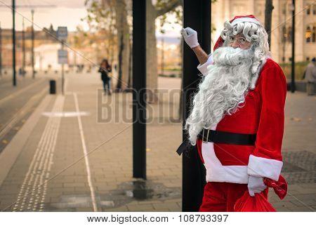 Santa Claus waiting at the bus station