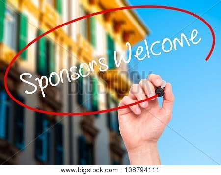Man Hand writing Sponsors Welcome with black marker on visual screen.