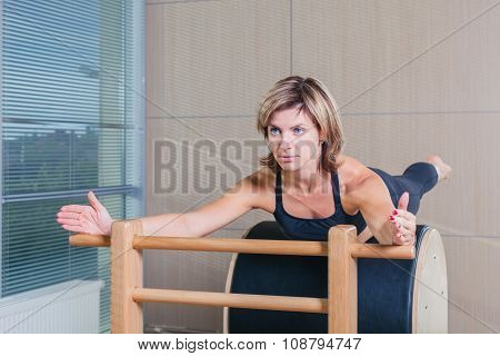 Pilates, fitness, sport, training and people concept - smiling woman doing  exercises on ladder barr