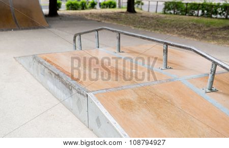 extreme sport, skateboarding, equipment and youth culture concept - close up of ramp at city skatepark