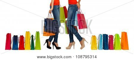 people, sale and consumerism concept - close up of women with shopping bags