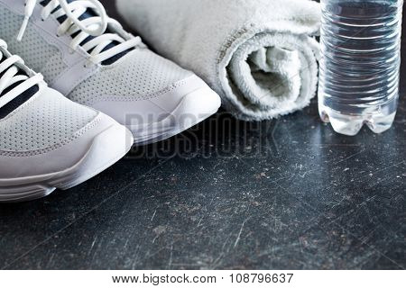 the sport concept. towel, shoes and water in bottle