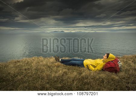 Female backpacker tourist in Icleand resting after a long day of adventures