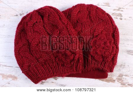 Woolen Cap For Woman On Old Wooden Background