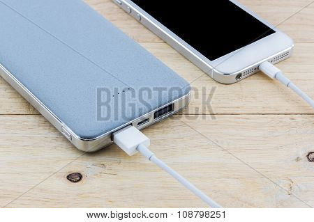 Smartphone With Grey Powerbank.