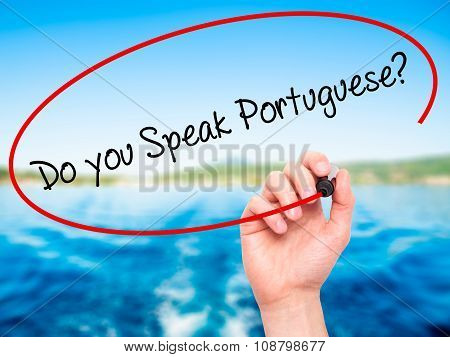 Man Hand writing Do you Speak Portuguese? with black marker on visual screen.