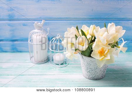 White Daffodils And Tulips  Flowers In Bucket And Candles