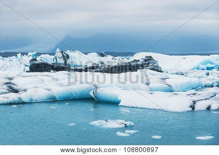 Beautiful Blue Icebergs In Jokulsarlon Glacial Lagoon.