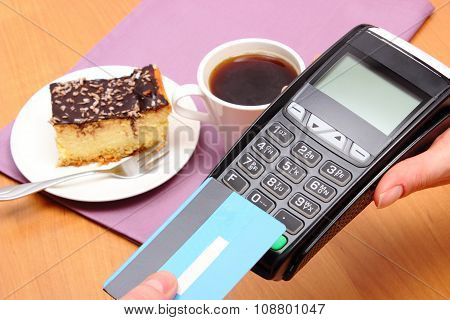 Paying With Contactless Credit Card For Cheesecake And Coffee In Cafe, Finance Concept