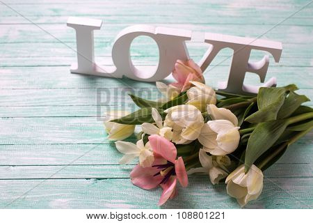 Fresh  White And Pink Tulips Flowers And Word Love On Wooden Turquoise  Background Turquoise.