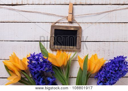 Postcard With Fresh  Spring Yellow Tulips, Blue Hyacinths  Flowers  And Empty  Blackboard