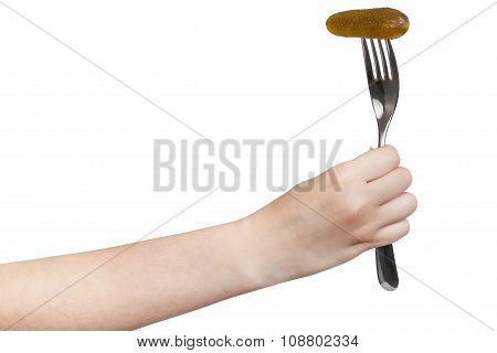 Hand Holds Fork With Impaled Pickled Gherkin