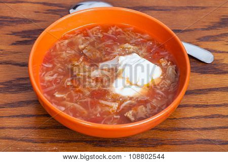 Cabbage Soup With Sour Cream In Ceramic Bowl
