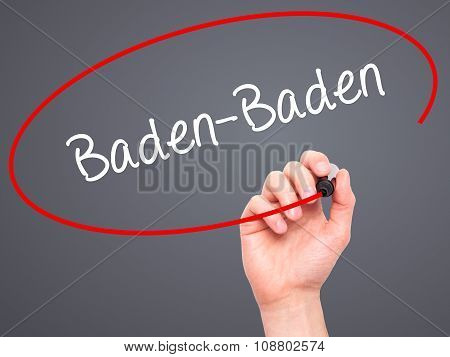 Man Hand writing Baden-Baden with black marker on visual screen