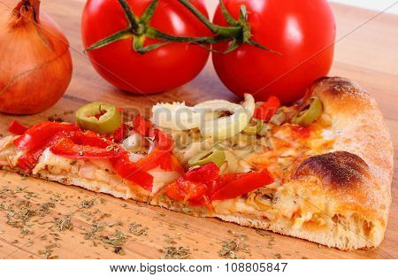 Vegetarian Pizza, Tomatoes Onion And Seasoning On Wooden Surface
