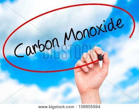 Man Hand writing Carbon Monoxide with black marker on visual screen.