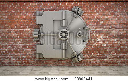 The Metallic Bank Vault Door On The Brick Wall. Concept Of Safety.