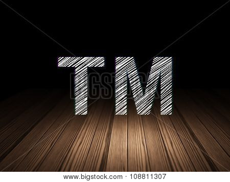 Law concept: Trademark in grunge dark room