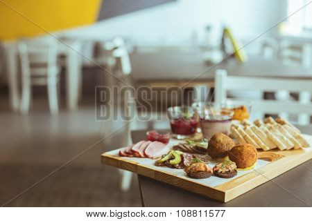 Various Tapas On Wooden Board