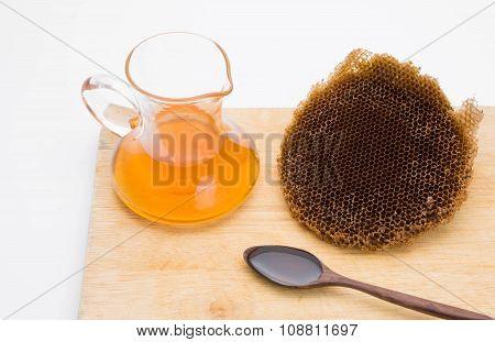 honey in bottle on wood