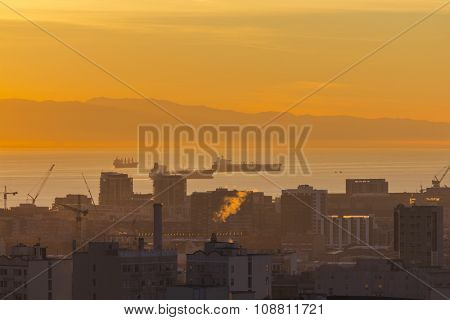 Warm dawn light on the urban San Francisco bay waterfront.