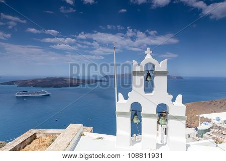 Traditional Greek White Church Arch With Cross And Bells In Village Fira Of Cyclades Island Santorin