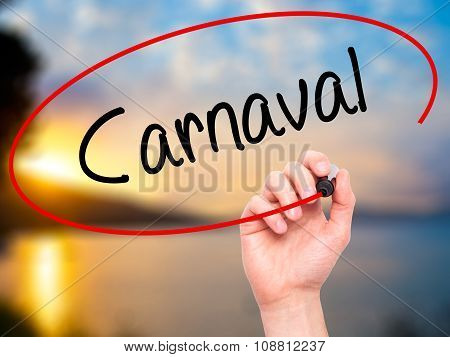 Man Hand writing Carnaval with black marker on visual screen.