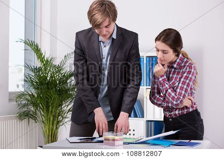 Manager And Employee Discussing Ideas