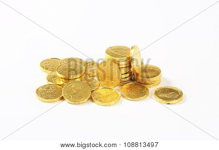group of chocolate coins on white background
