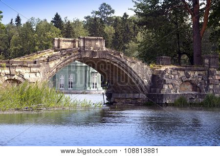 The ancient destroyed bridge in park and pavilion of Venus (1793) is visible under a bridge arch. Ga