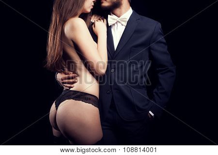 Gorgeous Woman In Underwear Next To Men In Suit