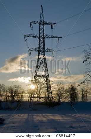 High-voltage Power Line Against Winter Landscape