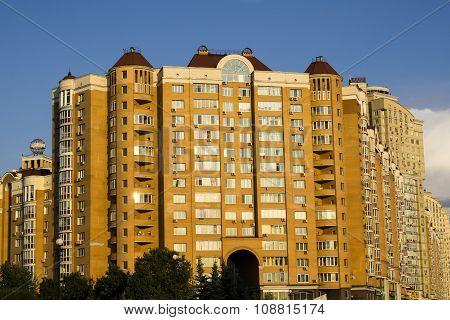 Kiev, Ukraine - July 15, 2015: Modern Multi-storey Orange Big House On Background Of Blue Sky