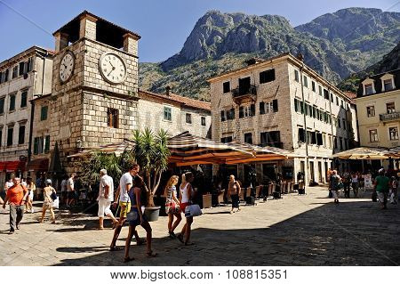 Tourists Visit Kotor Square Of Arms