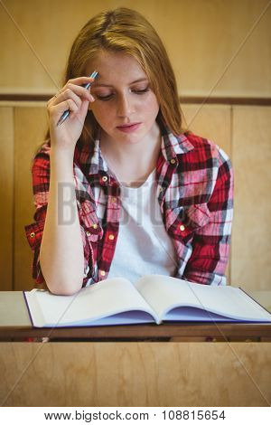 Focused student studying on notebook at the university