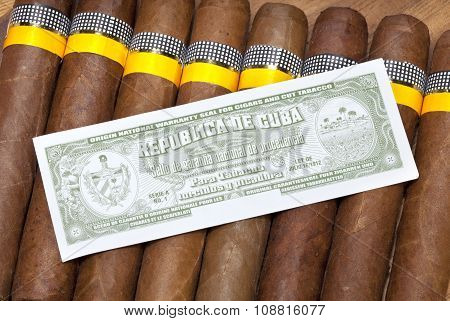The Cuban cigars twisted manually and the certificate of authenticity
