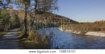 Riverside Walkway Isar River In Autumnal Landscape