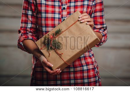 Hand crafted gift box in woman hands