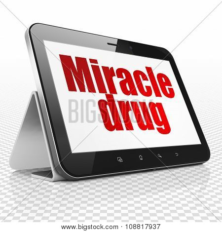 Healthcare concept: Tablet Computer with Miracle Drug on display