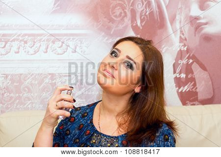 Beautiful Middle-aged Woman Applies Perfume.