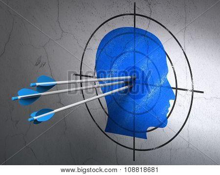 Marketing concept: arrows in Head target on wall background