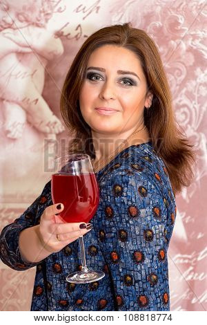 Portrait Of A Beautiful Middle-aged Woman With Glass Of Wine.