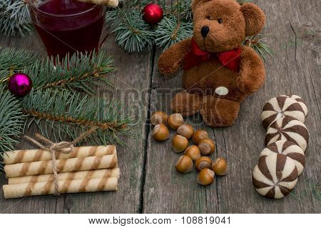 Coniferous Branch, Linking Of Cookies, Tea And Toy Bear