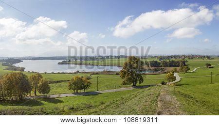 Panoramic View To Lake Riegsee On A Sunny Day