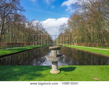 Stone fountain by the beautiful pond in the park of Kasteel De Haar