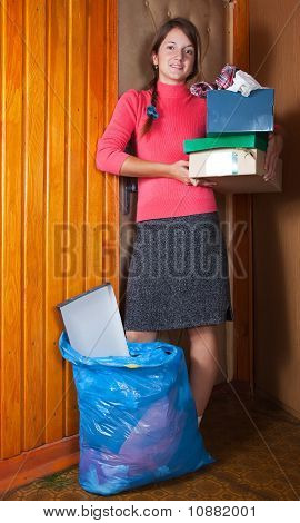 Woman Tossing Out The Garbage