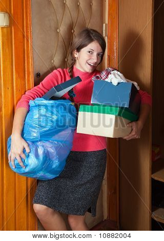 Woman Taking Away The Garbage